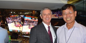 Photo of Jimmy Yang, Kenda president of North America and honorary team captain for the Cavs opening game last night with Kerry Bubolz, Cleveland Cavaliers president of business operations.