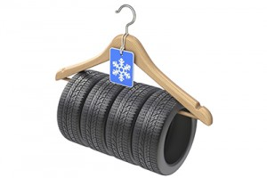 Winter car tyre on wooden hanger