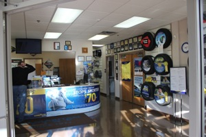 well-kept and relatively uncluttered, the front sales counter at samaritan tire.
