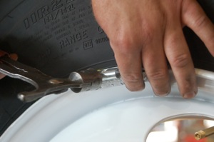 The most common and oldest practice of balancing a tire/wheel assembly is to add wheel weights attached to the wheel rim flange or other locations on the wheel surface.