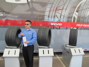 alan ngo, nitto staff engineer, goes over the features of each tire run during the driving event.