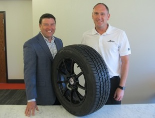 Scott Jamieson, director of product management (left), and Bruce Sanborn, product segment manager, show off the features of Coopers new CS3 Touring tire.